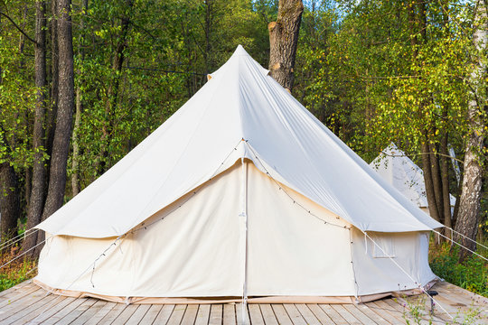 Canvas glamping tent at forest