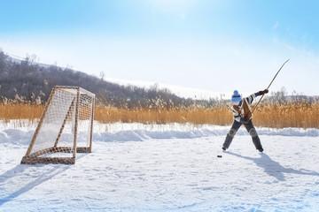 Young hockey boy trains alone