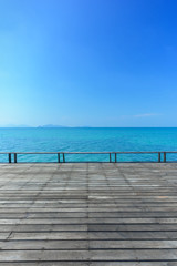 Wood floor on blue sea background
