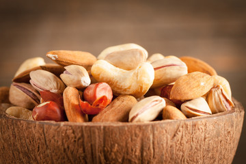 mix of nuts on a wooden table