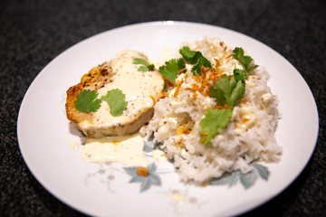 Pork medallion with white jasmine rice, served with fried onion and flat parsley
