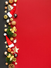 Christmas decoration background red with santa hats glass balls twig apples nuts