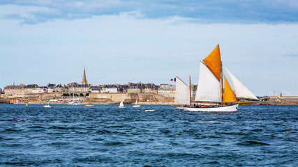 Seaside view of Saint Malo and sailboat