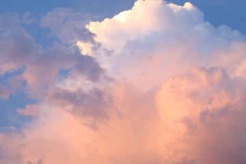 Clouds on the blue sky with pink tint
