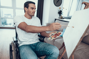 Portrait of Disabled Young Man Painting Picture
