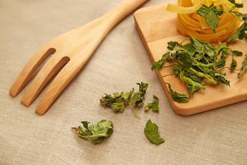 Raw pasta and dry basil