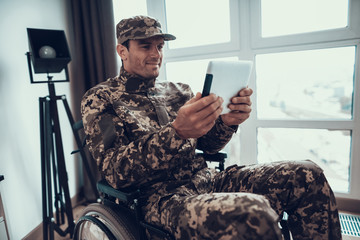 Disabled Military Man Uses Tablet in Wheelchair