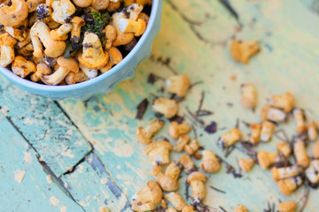 Chanterelles mushrooms on teal and yellow wooden table