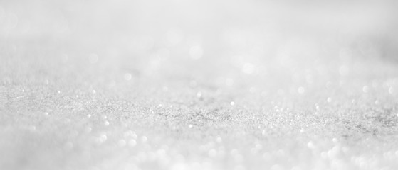 Abstract of Bright and sparkling bokeh background. silver and diamond dust bokeh blurred lighting from glitter texture