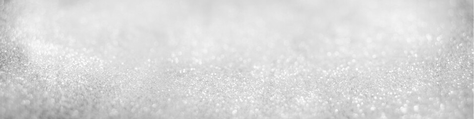 Abstract of Bright and sparkling bokeh background. silver and diamond dust bokeh blurred lighting...