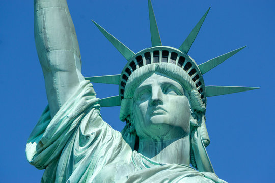Statue of Liberty front close up on a blue sky background New York City