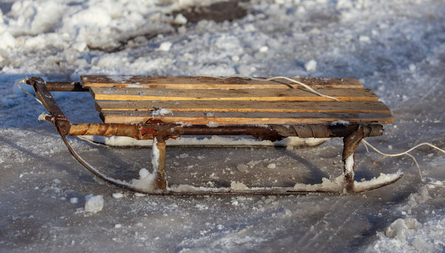 Old sled in the snow in winter