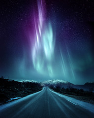 Aluminium Prints Northern lights A quite road in Norway with a spectacular Northern Light Aurora display lighting up the night sky above the mountains. A popular destination within the arctic circle for hunting the Northern Lights.