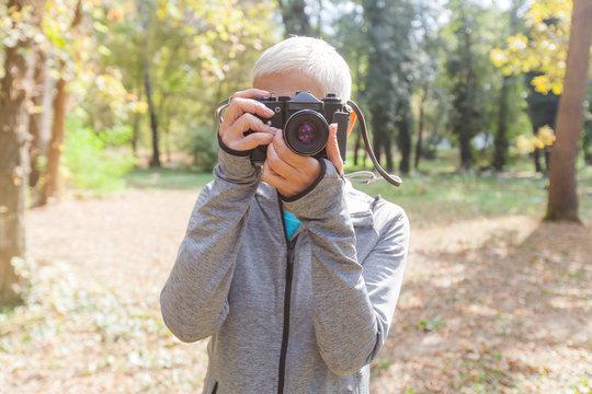 Senior Woman With Retro Camera Outdoor