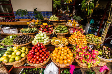 Many fresh and ripe exotic fruits on traditional farmer market Mercado dos Lavradores, Funchal, Madeira island, Portugal