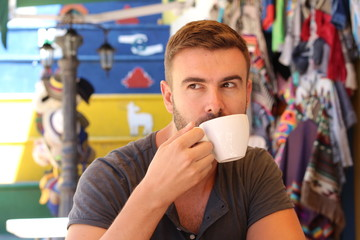 Handsome man drinking a cup of coffee