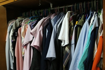 Clothes on a hanger in a closet