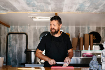 Smiling man working in food truck
