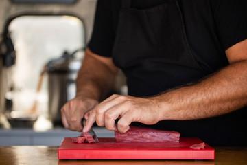 Crop chef slicing fresh tuna