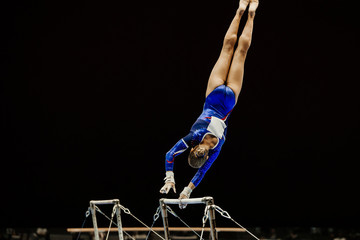 Aluminium Prints Gymnastics uneven bars performing female gymnast at artistic gymnastics