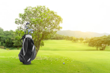 Golf equipment and golf bag , putter, ball on green and golf course as background