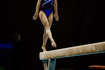 female gymnast on balance beam at artistic gymnastics