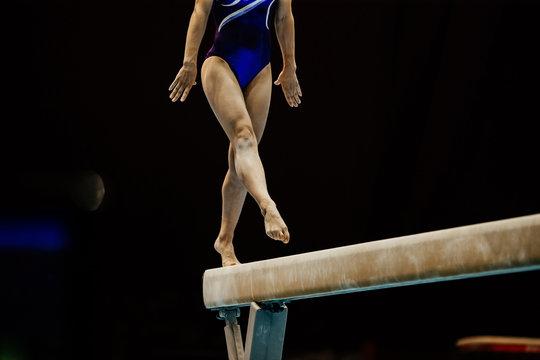 female gymnast on balance beam at artistic gymnastics
