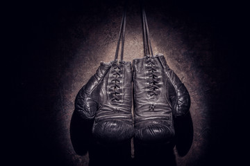 Wall Mural - old boxing gloves on a brown background