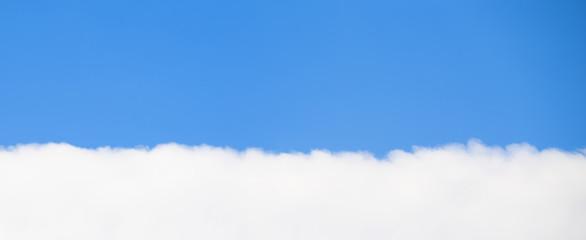 Single cloud with blue sky