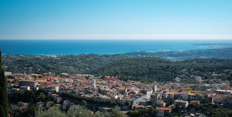 View of Vence, Provence from a mountain road above the town, mediterranean sea behind