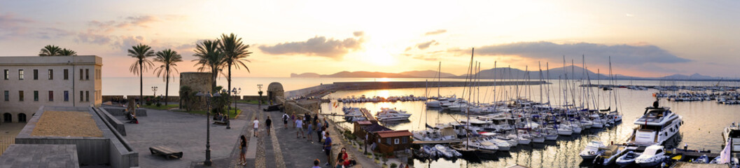 Alghero, Italy - Panoramic view of the Alghero historic quarter and marina with St. Elm Tower