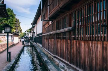 Old houses and Japanese tourist on street and small natural stream of Hida Furukawa town, Gifu. Japan