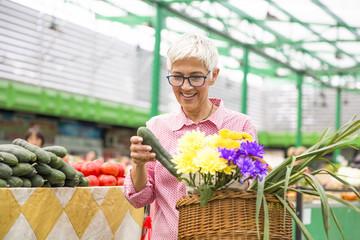 Senior woman buying  on market