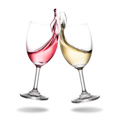 Cheering wine with splashing out of glass isolated on white background.