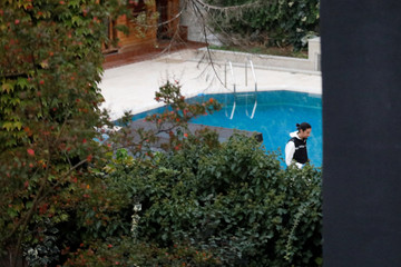 A Turkish police expert examines the garden of Saudi Arabia's Consul General Mohammad al-Otaibi's residence in Istanbul