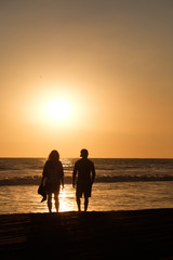 couple on the beach of the pacific ocean in Guatemala during sunset