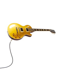 Vintage Gold top electric solid body guitar plugged in, isolated on white. Single cutaway.