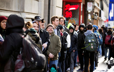 People wait in line for the opening of the Quebec Cannabis Society store, on the day Canada legalizes recreational marijuana in Montreal