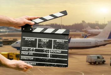 Movie clapperboard on airport background