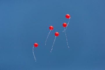 red balls in the blue sky