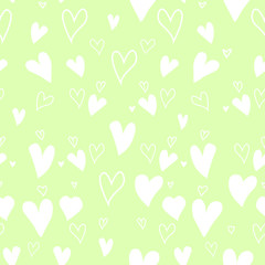 Seamless pattern with hearts on green background. Wallpaper and fabric design.