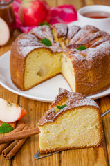 Delicious apple pie with cinnamon and caramel sauce. Traditional cake Charlotte.
