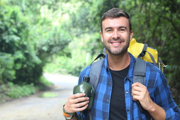 Healthy backpacker going through the jungle