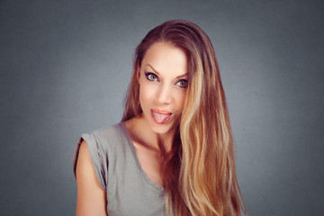 woman shows tongue bullying someone