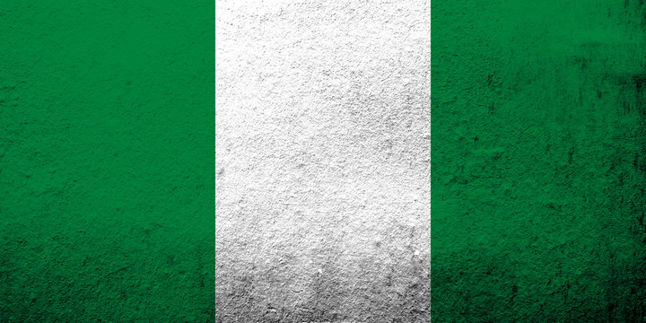The Federal Republic of Nigeria National flag. Grunge background