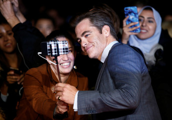 Actor Chris Pine takes a selfie with a fan at the European Premiere of Outlaw King during the London Film Festival, in London