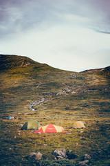 Foto op Aluminium Arctica Tent camp in mountain valley. Norwegian region of Oppland or Highlands