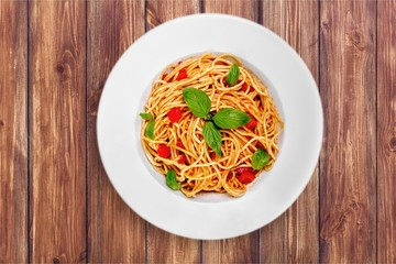 Spaghetti pasta with tomatoes and parsley on