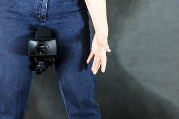 Professional photographer with a camera. Photography and paparazzi concept.