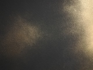 Black with gold concrete wall texture or grunge style background